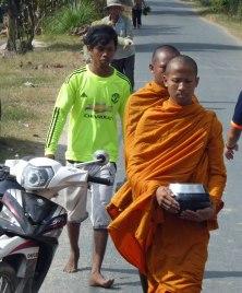 MonksWalkingKhmerVillage